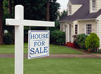 house with sign in yard